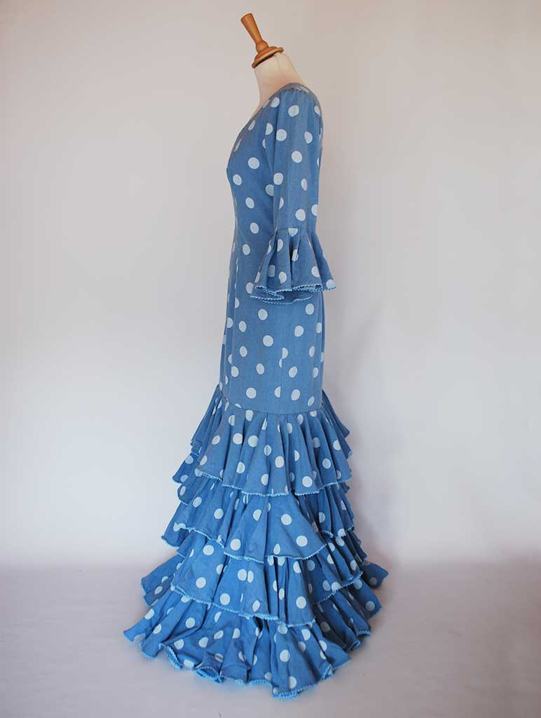 Tradicional flamenco dress. Blue with dots. Feria de Abril. Sevilla Spain
