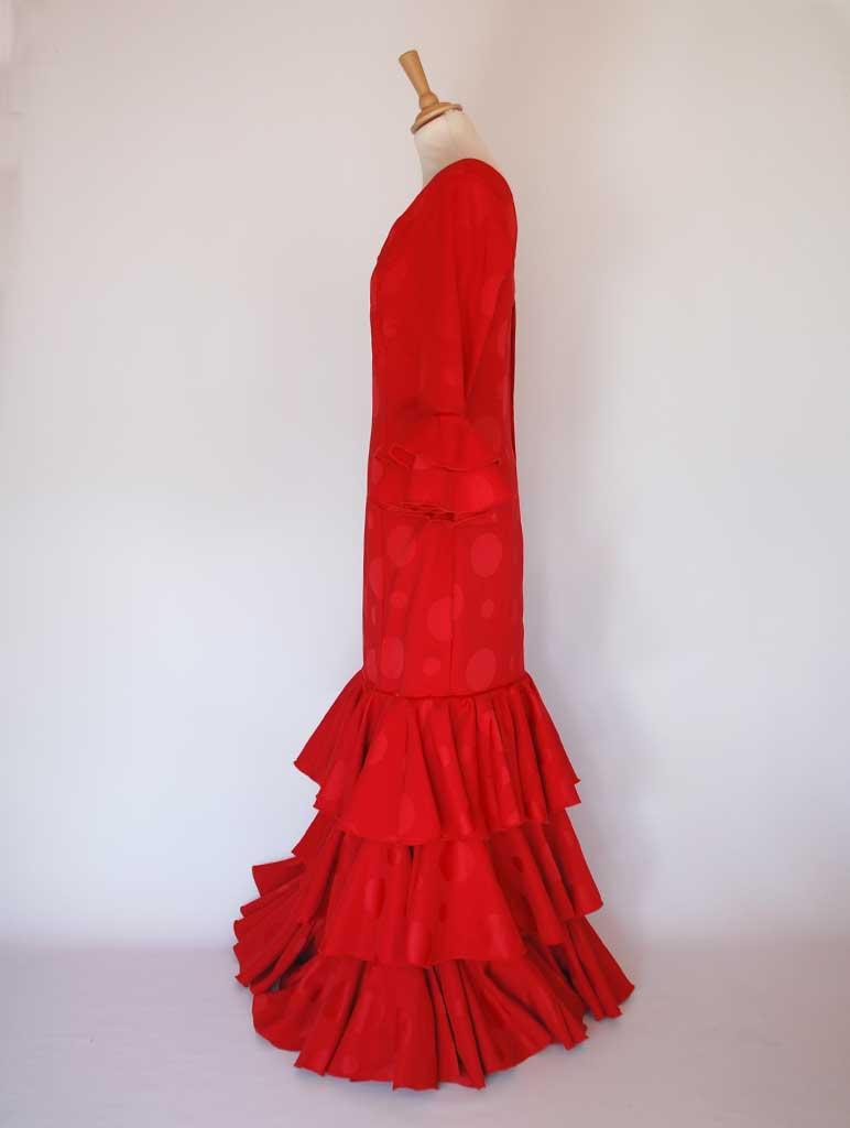 Traditional spanish dress. Red, flills dots. Flamenco. Feria Sevilla